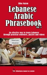 This is the cover for Lebanese Arabic Phrasebook Vol. 1. It is red, with a white title. The subtitle reads: An effective way to learn Lebanese through practical sentences, puzzles and videos. The image on the cover shows Hiba Najem at a Shawarma place saying: Thank you, which translates into 'Shoukran'